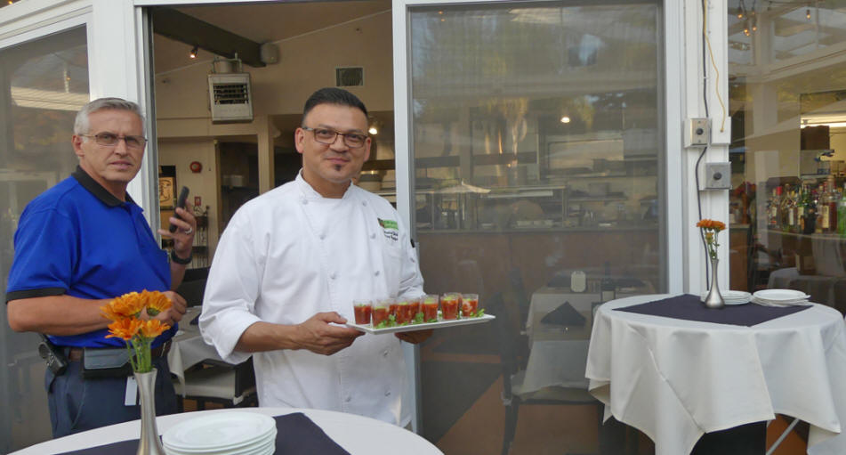 Chef Gerry holding Bloody Marys and maintance manager at Dinahs Poolside Restaurant in Palo Alto , CA