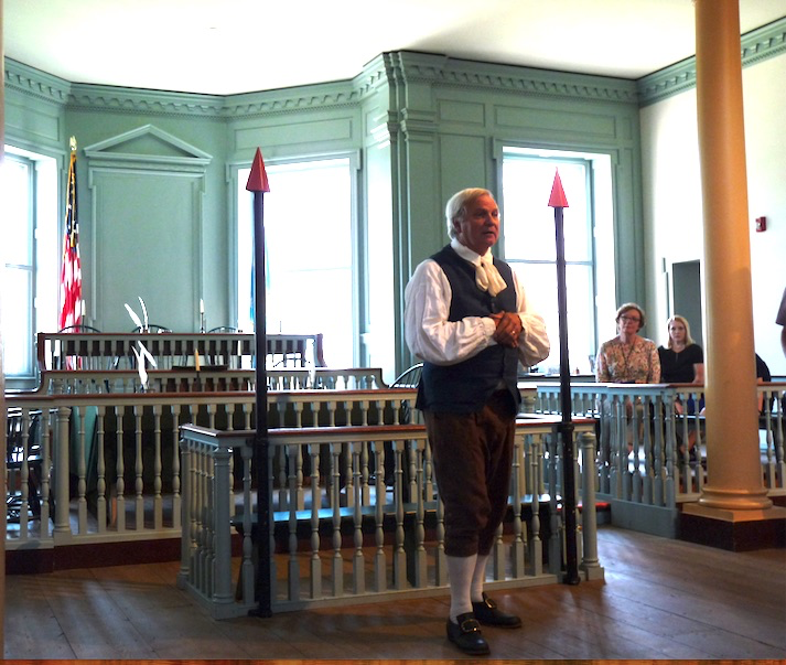 Male Reenactor Dover at Old Statehouse courtroom magistrate's bench