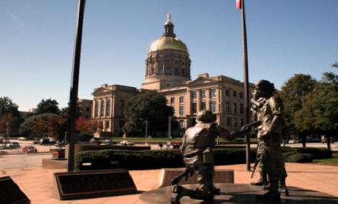 <h1>Atlanta capitol building with veterans statures</h1> in foreground