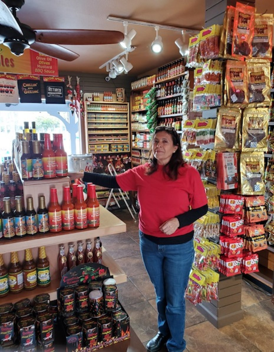 woman standing by h9ot sauce display
