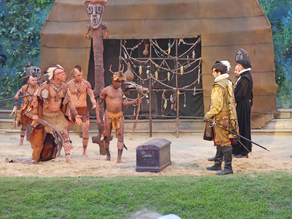 scene in The Lost colony Play where natives confront Spanish explorers