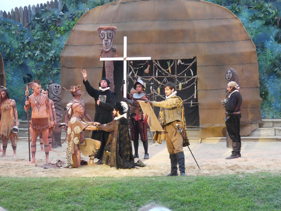 scene in The Lost colony Play where priest blesses native american as others look on