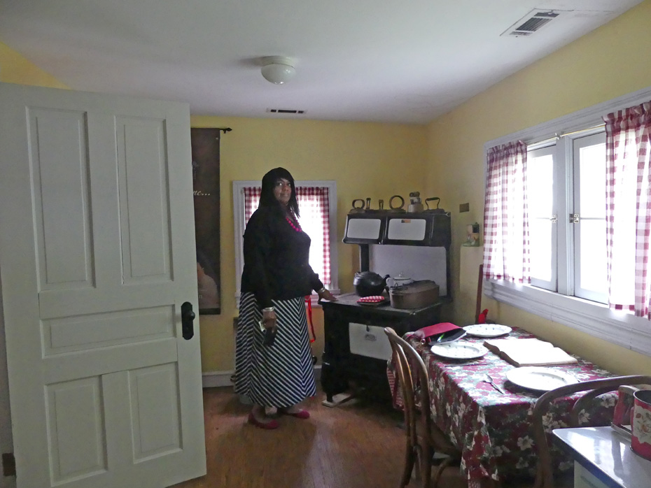 woman at old fashioned stove in McLemore house