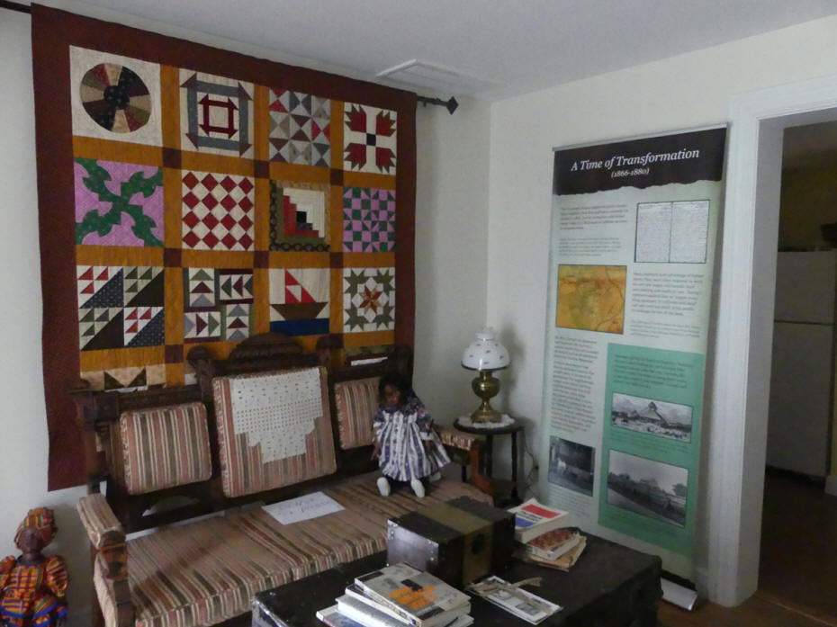 Living room of McLemore House showing artifacts from African american history.