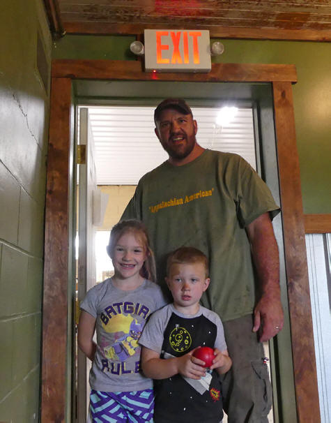 Owner and two children at Flying Buck Distillery