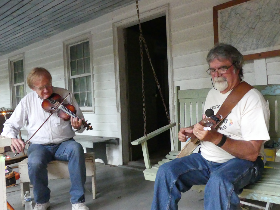 two musicians on porch od Miller House