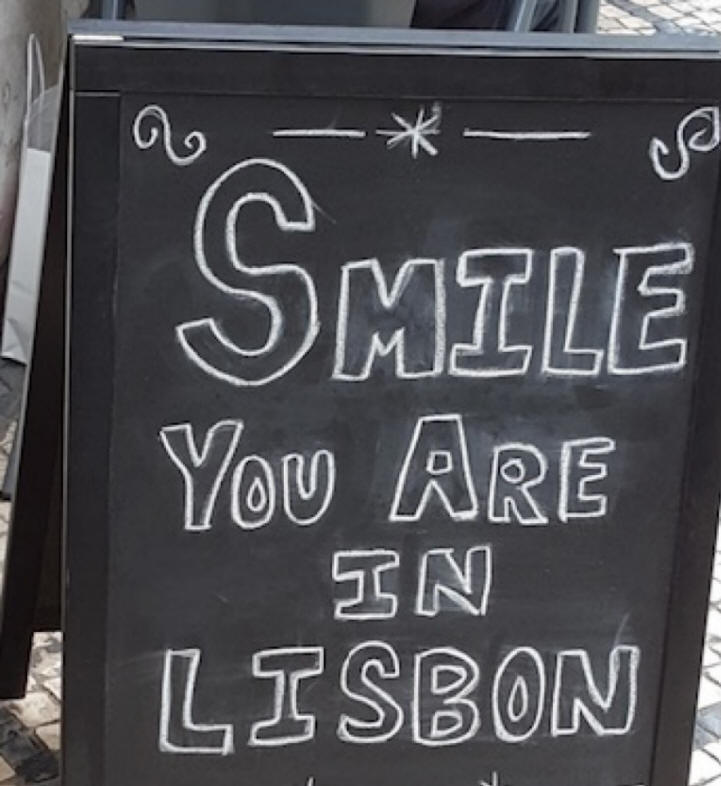 sign saying smile you are in Lisbon