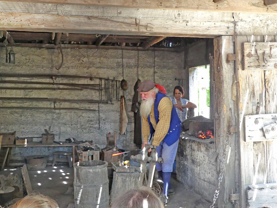 docens in Spanish colonial costume at blacksmith shop