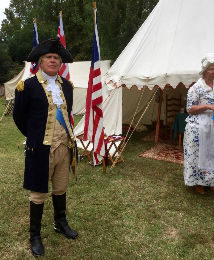 Reenactor dressed in Revolutionary War costume at North Augusta's Living History Park.