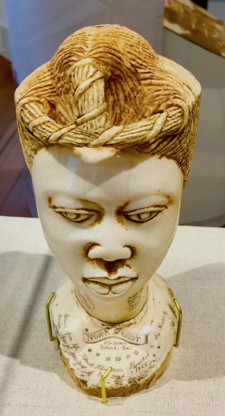 Front view The bust of Nora August, carved in ivory,