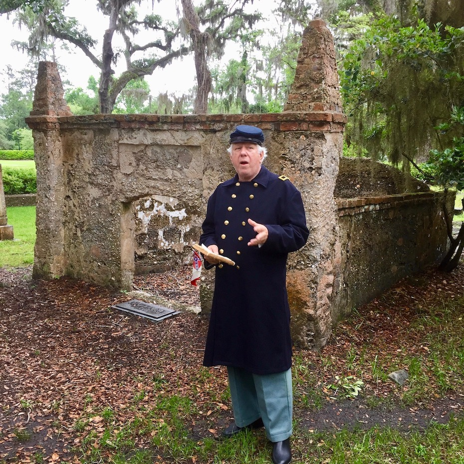 Confederate reenactor in front of tomb at Simons Island cemetery at Christ Church.