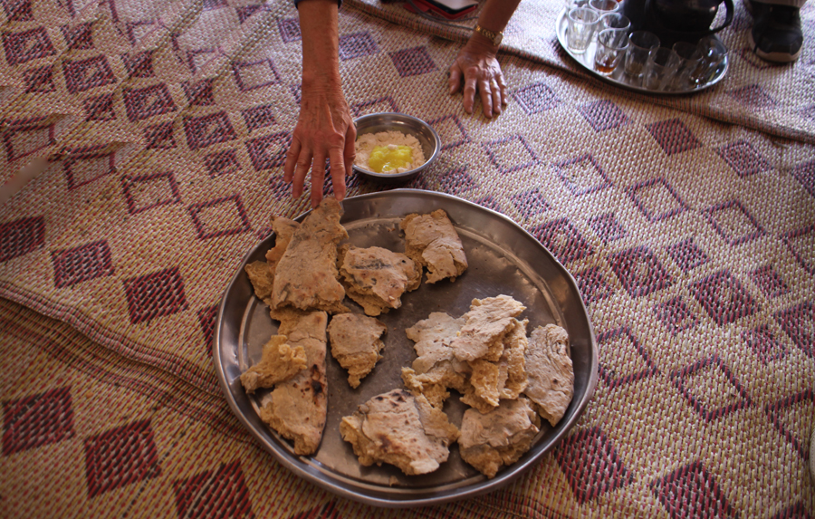 Bread being served in Bedouin tent