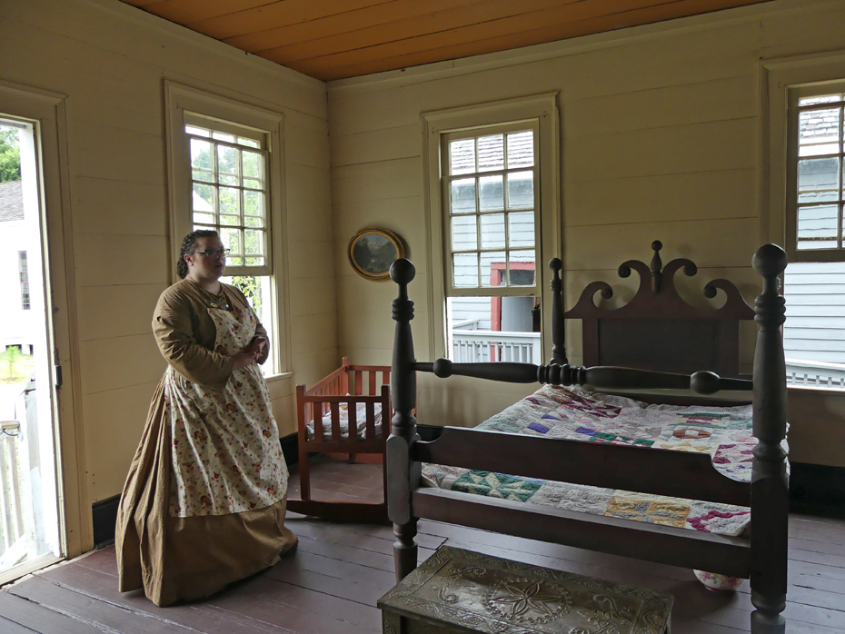 docent shows 19th centurey bedroom at westville